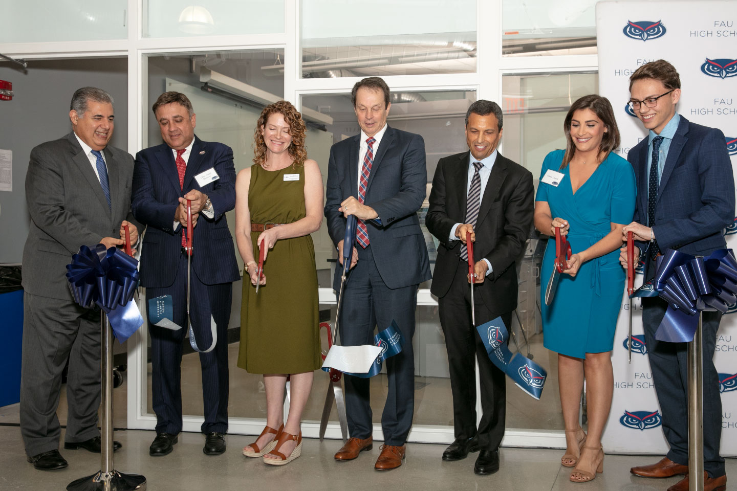 From left to right, Anthony Barbar, FAU Board of Trustees chair emeriti; FAU Board of Trustees Chair Abdol Moabery; Tricia Meredith, Ph.D.; FAU President John Kelly; Joel Herbst, Ed.D.; Gianna Caserta; Nick Pizzo. (Photo by Alex Dolce)